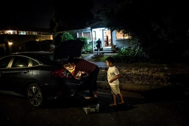 Erika González and her son, Kevin, evacuating their Sonoma County, California home.