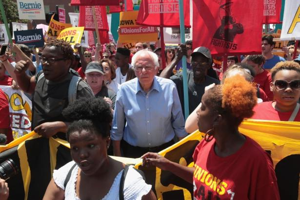Bernie Sanders amidst a union rally