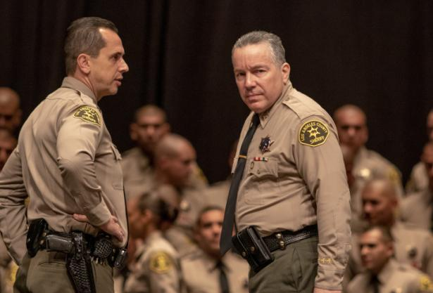 Los Angeles County Sheriff Alex Villanueva (r).