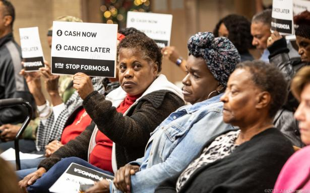 African-American women at a meeting protesting pollution