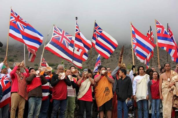 Maunakea protectors blow the Pū or conch shell to mark the ceremonial beginning of their protest.