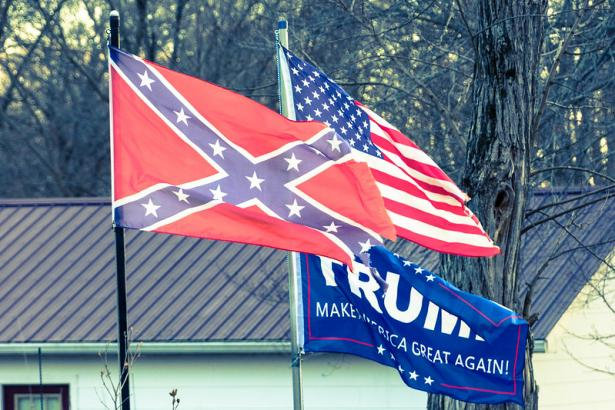 The Confederate Flag, the US Flag, and a Donald Trump flag.