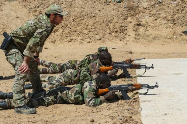 A US Army Special Forces sergeant oversees the marksmanship training of a Niger Army soldier.