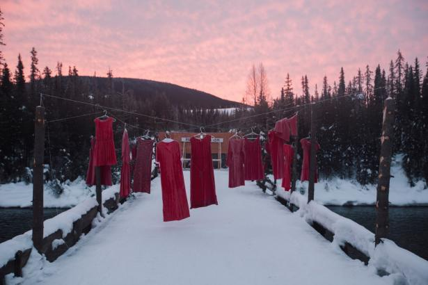 Hanging red dresses signify missing and murdered Indigenous women.