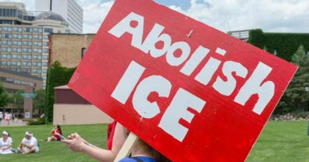 "demonstration with poster calling for ""Abolish ICE"""