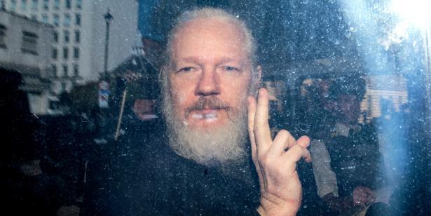 https://portside.org/sites/default/files/styles/large/public/field/image/assangearrest.jpg