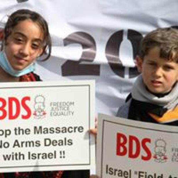 children holding BDS posters