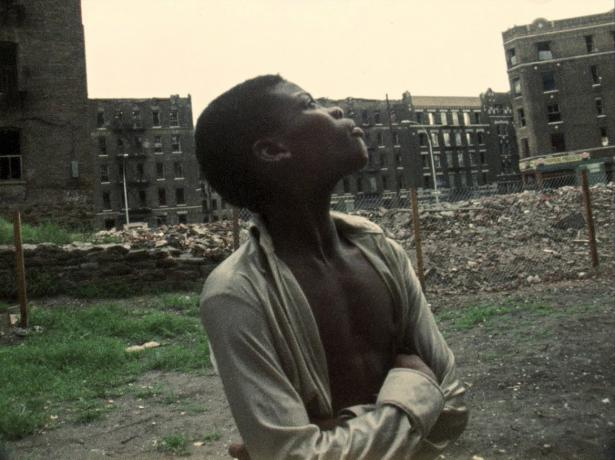 young Black man in vacant lot