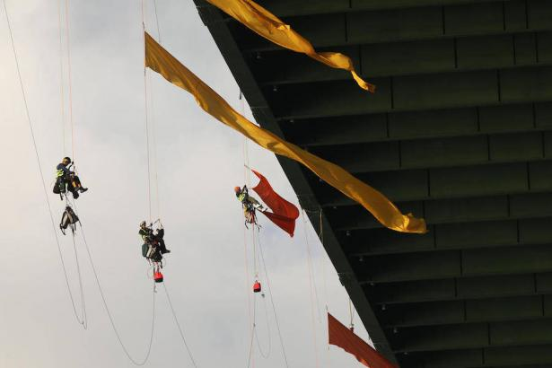 Greenpeace protesters shutdown the Houston Ship Channel Sept. 12 by hanging from a bridge.