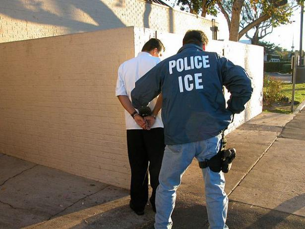 ICE agent handcuffing man
