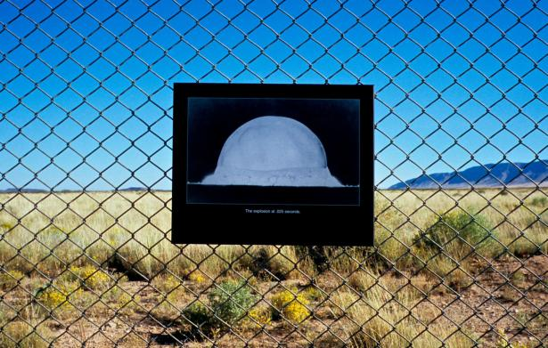 nuclear explosion sign on fence