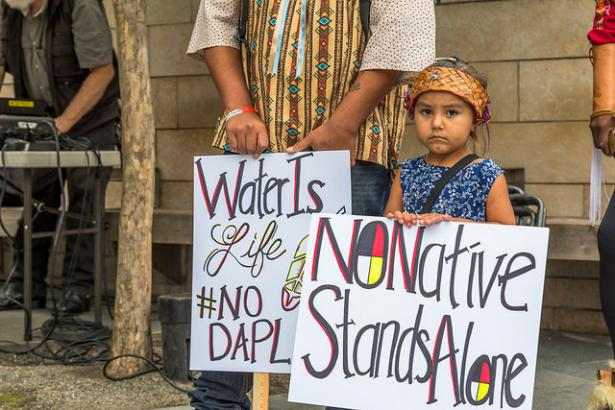 Native American mother and child protesting