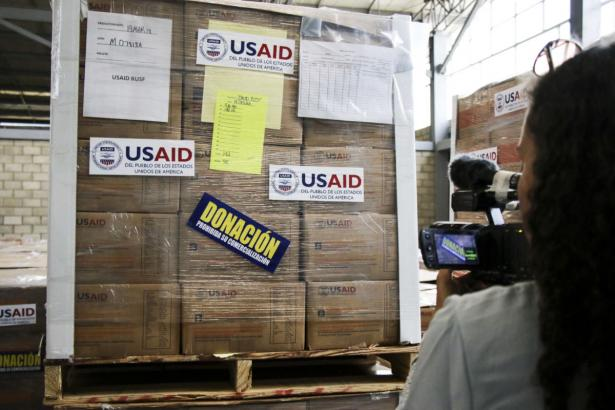 boxes packed for shipping and labeled USAID