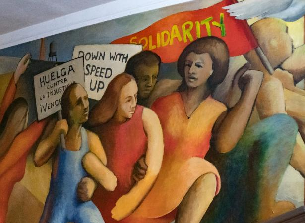 women workers painted in a mural