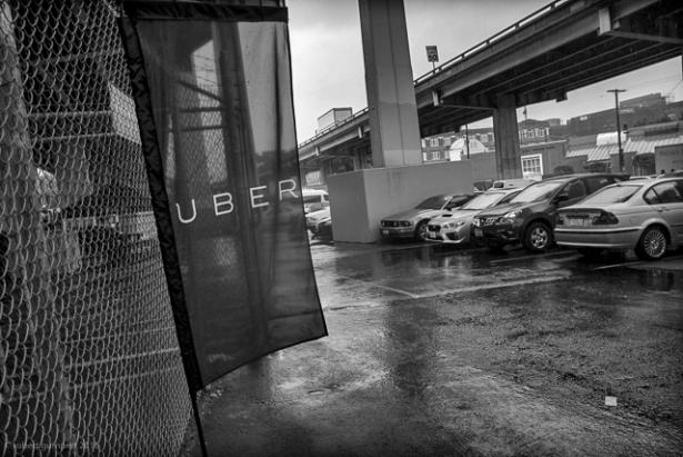 cars parked at Uber sign