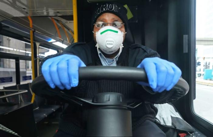 bus driver waering mask and gloves