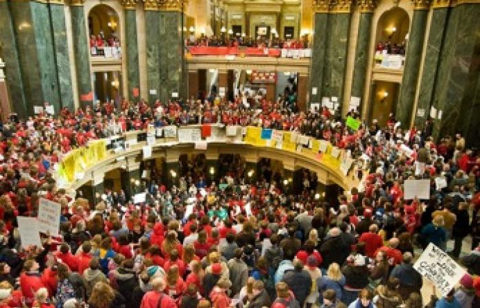 demonstrators fill Wisconsin State chambers