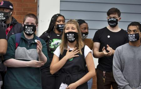 Eight protesters wearing Black Lives Matter Masks