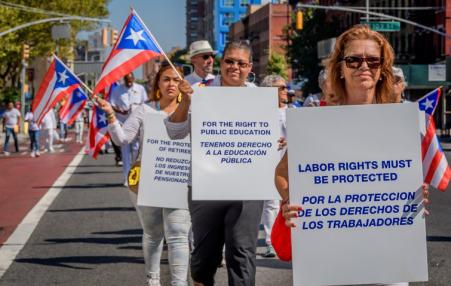 Puerto Ricans participate in a silent protest in New York.