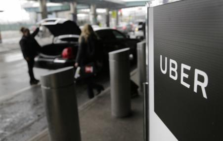 A sign marks a pick-up point for the Uber car service at LaGuardia Airport in New York.