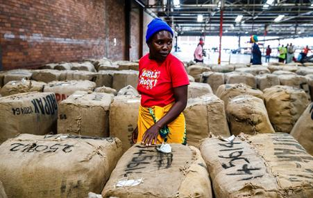 woman farmer at African tobacco warehouse