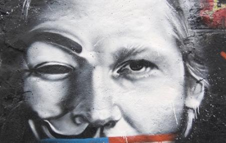 Julian Assange muzzled by USA flag