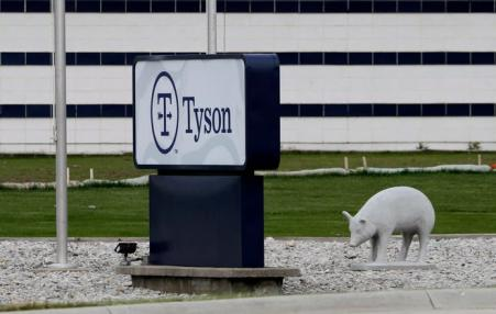 Tyson signage outside of packing plant alongside a ceramic pig.