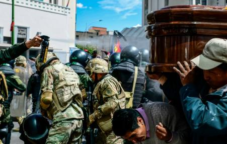 police attacking funeral in Bolivia