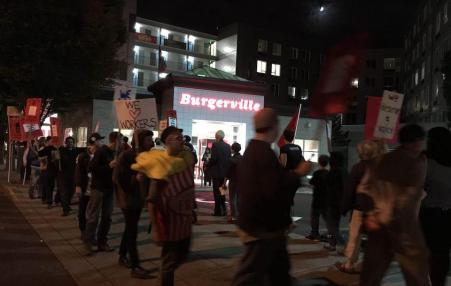 Supporters of the Burgerville Workers Union picket outside the fast-food chain's Lloyd Center restaurant. Credit: Burgerville Workers Union
