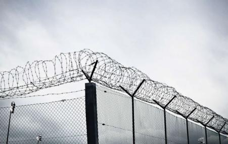 prison fence with barbed wire