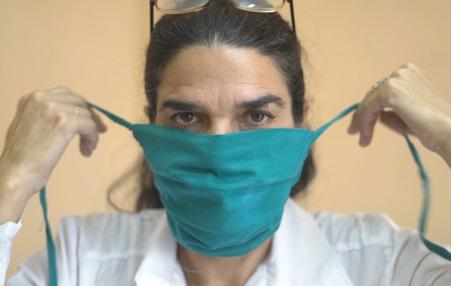 Cuban doctor putting on mask