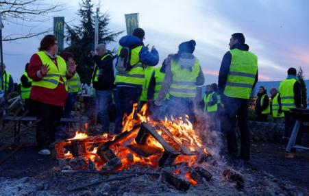 Protestors around a fire.