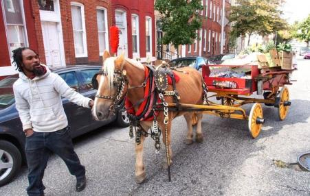 Yusuf Abdullah, one of the city's horse-cart produce vendors known as arabbers, leads Tony and his cart through the streets of Baltimore, Maryland.
