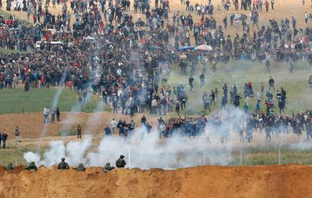 Paelstinian demonstrators under Israel attack
