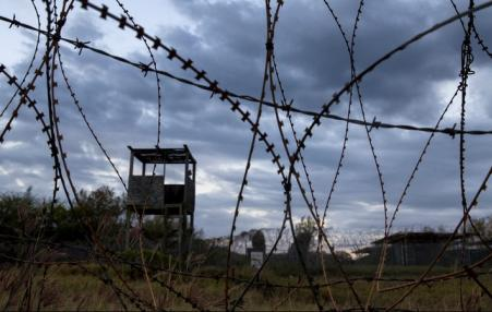 barbed wire and prison guard tower