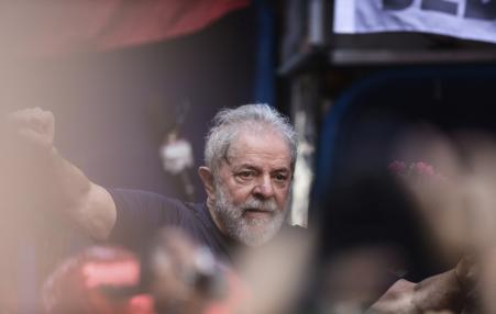 Lula with raised fist.
