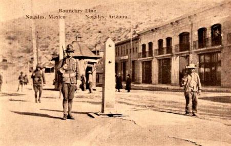 In 1914, US and Mexican soldiers march up and down to maintain the boundary between Nogales, Arizona and Nogales, Sonora, Mexico.