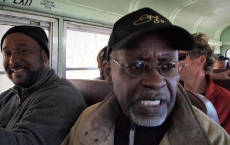 African-American men sitting in a bus