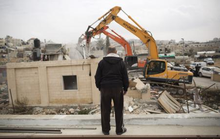 Man watching home being destroyed