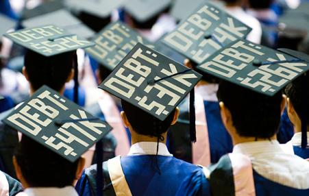 student graduation caps with debt protest