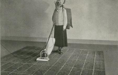 Woman vacuuming.