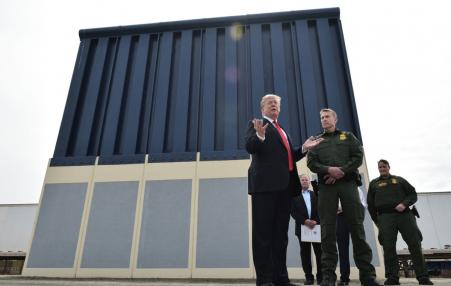 Trump standing in front of sample wall
