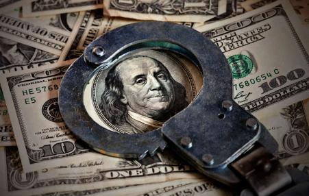 dollar bill with handcuffs