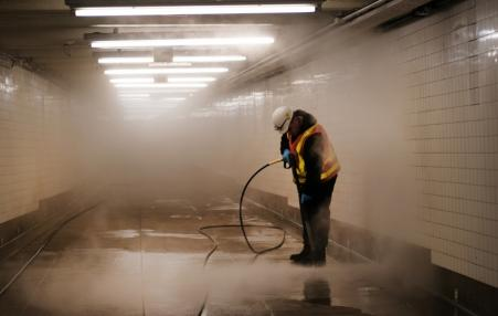 Worker seen cleaning a subway station